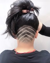 Undercut being shaved and then a v pattern shaved in 6 lines at tge back of the haircut done by Anna at the klinik hairdressing London