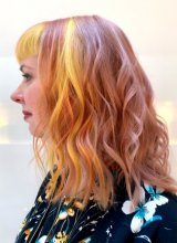 Pink, Yellow and orange hair curled into a beachy finish done by Anna at the klinik hairdressing London