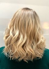 Medium long hair with blonde highlights to give textured beachy effect at the klinik salon