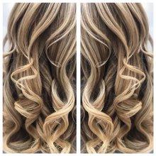 Long balayaged hair curled into perfection by Leyla at the klinik hairdressing London