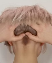 Hair with hands on the back to form a heart at the klinik hairdressing London