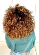Big curly hair coloured natural sunkissed at the klinik salon London