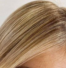 close up photo of a face framing hair colour called the money piece at the klinik hairdressing LOndon