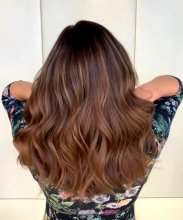 Girl with long tousled waves as an colour melt ombre done by Anna at the klinik salon London
