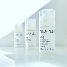 Three Olaplex no 8 bottles standing in a row at the klinik salon London