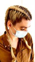 Girl with two cornrow plaits at the klinik salon